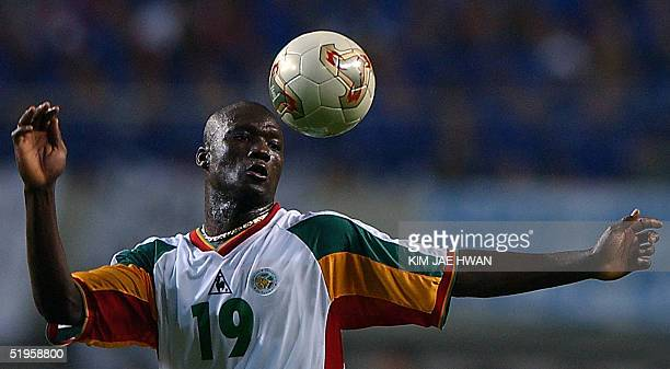 Senegalese midfielder Pape Bouba Diop heads the ball during his opening game with France for the 2002 FIFA World Cup Korea/Japan in Seoul, 31 May...