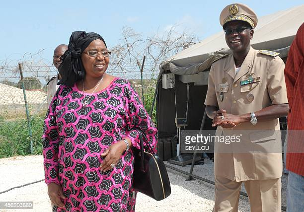 Senegalese Minister of Health Awa Marie Coll Seck accompanied by General Lamine Kane walks over to speak to the press after flying in on a World Food...