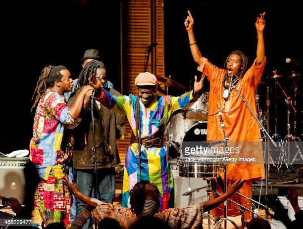 Senegalese musician Cheikh Lo bows with his band during a Carnegie Hall and World Music Institute concert in the 'World Views' series at Zankel Hall...