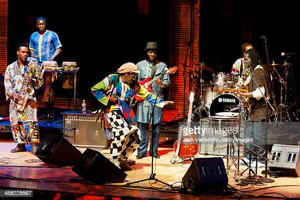 Senegalese musician Cheikh Lo leads his band during a Carnegie Hall and World Music Institute concert in the 'World Views' series at Zankel Hall at...