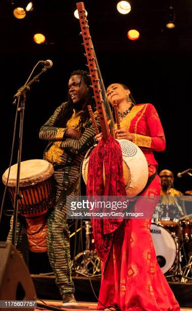 Senegalese musician Mamadou Sarr on djembe and BritishGambian musician singer and griot Sona Jobarteh on kora perform together during a World Music...