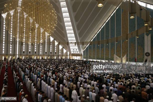 Senegalese muslims gather to perform Eid alFitr prayer at the Faisal Mosque at the end of Ramadan in Islamabad Pakistan on June 16 2018