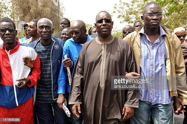 Senegalese opposistion leaders former President Macky Sall march on April 3 2010 in Dakar to demand President Abdoulaye Wade's resignation as the...