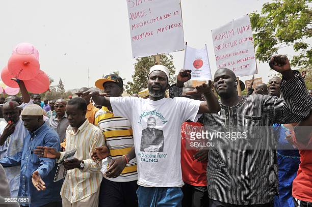 Senegalese opposistion supporters march on April 3 2010 in Dakar to demand President Abdoulaye Wade's resignation as the country prepared to...