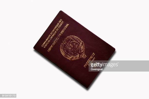 senegalese passport isolated on a white background - gwengoat stock pictures, royalty-free photos & images