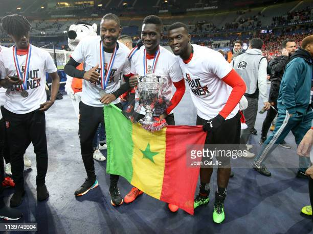 Senegalese players Abdoulaye Diallo Ismaila Sarr MBaye Niang of Stade Rennais celebrate the victory following the French Cup Final between Stade...