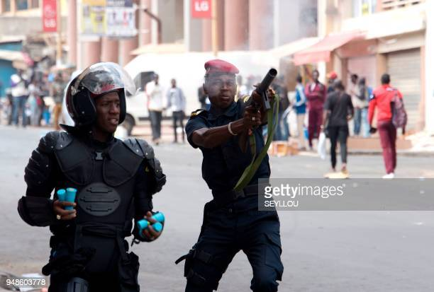 Senegalese policemen fire tear gas during antigovernment demonstrations in Dakar on April 19 2018 Senegal police fired tear gas to break up an...