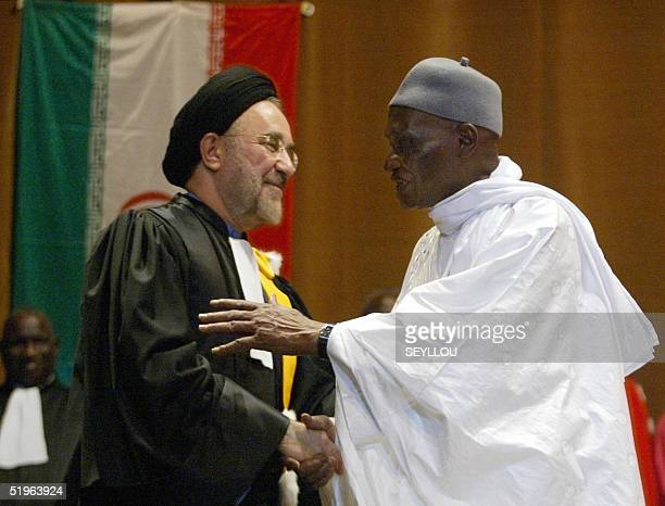 Senegalese President Abdoulaye Wade congratulates Iranian President Mohammad Khatami after he was awarded an honorary doctor's degree by Abdu Salam...