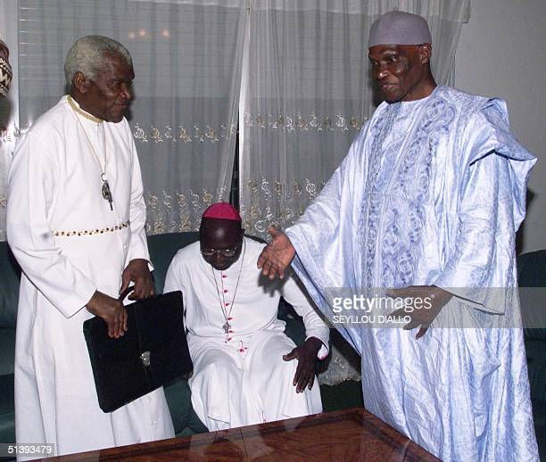 Senegalese President Abdoulaye Wade is about to greet Priest Diamacoune Senghore secretary general of the separatist Casamance Movement of Democratic...