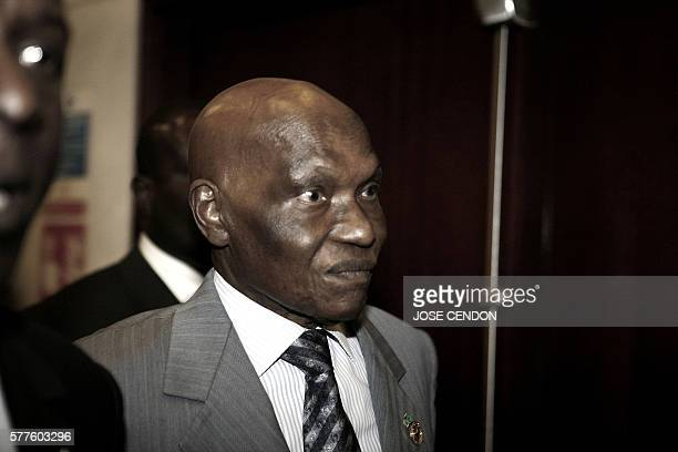 Senegalese President Abdoulaye Wade walks at the United Nations Conference Hall after a meeting of the 10th African Union Summit 01 February 2008 in...