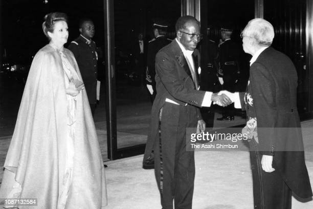 Senegalese President Leopold Sedar Senghor and his wife Colette Hubert Senghor are welcomed by Emperor Hirohito prior to the state dinner at the...