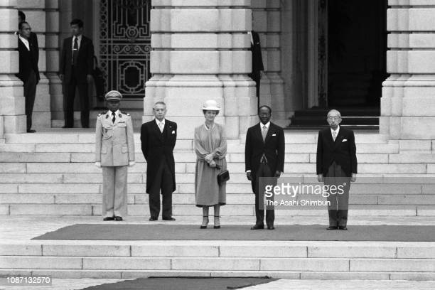 Senegalese President Leopold Sedar Senghor and his wife Colette Hubert Senghor attend the welcome ceremony with Emperor Hirohito at the Akasaka State...
