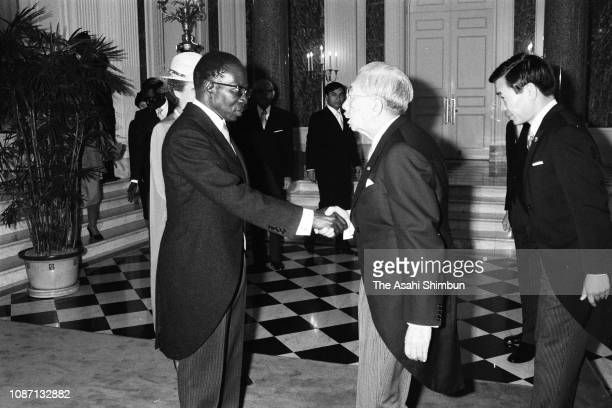 Senegalese President Leopold Sedar Senghor and his wife Colette Hubert Senghor greet Emperor Hirohito prior to the welcome ceremony at the Akasaka...