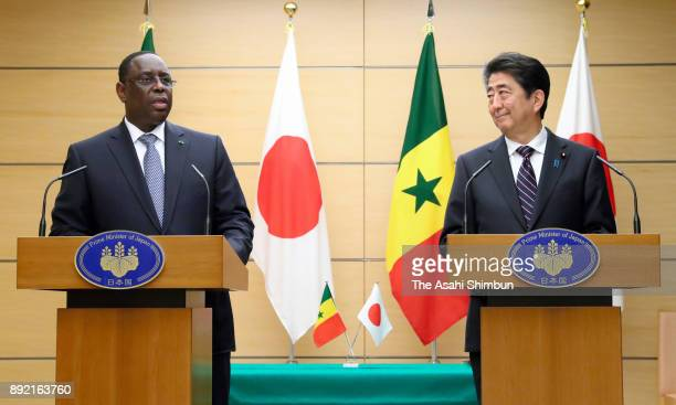 Senegalese President Macky Sall and Japanese Prime Minister Shinzo Abe attend a joint press conference following their meeting at the prime...