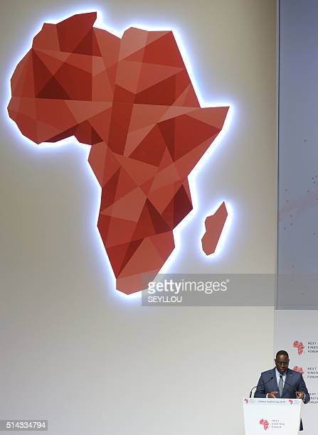 Senegalese President Macky Sall delivers a speech under a map of Africa in Dakar on March 8 during the opening of the 'Next Einstein Forum' Africa's...