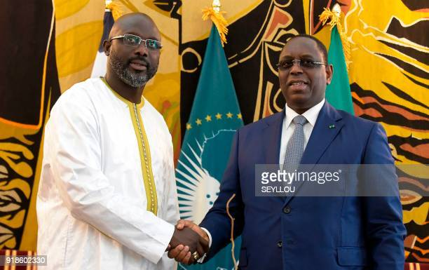 Senegalese president Macky Sall shakes hands with his Liberian counterpart George Weah during their meeting at the presidential palace in Dakar on...