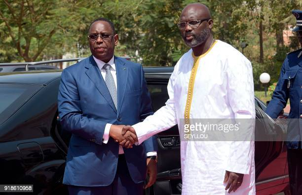 Senegalese president Macky Sall shakes hands with his Liberian counterpart George Weah ahead of their meeting at the presidential palace in Dakar on...