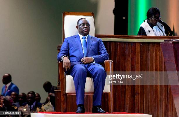 TOPSHOT Senegalese President Macky Sall sits during his swearingin ceremony in Diamniadio a new city around 30 kilometers from the capital Dakar on...