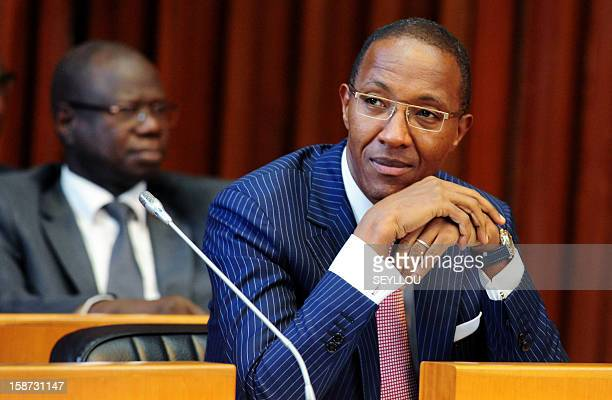 Senegalese Prime minister Abdoul Mbaye looks on December 26 2012 at the National Assembly in Dakar where MPs rejected a motion of censure tabled by...