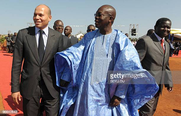 Senegalese Prime Minister Ndene Mbaye speaks with Minister of State of Senegal Karim Wade and Senegal's Minister of Economy and Finance Abdoulaye...