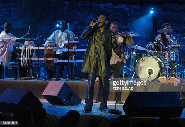 Senegalese singer Youssou N'dour performs during the Carthage International Festival on July 16 2008 at the Romain Amphitheatre in Carthage near...