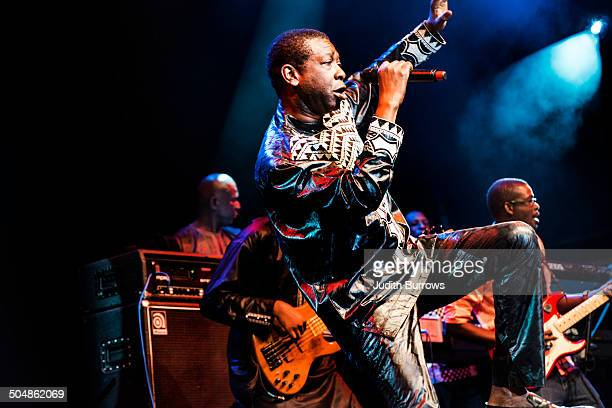 Senegalese singersongwriter and musician Youssou N'Dour performing with his band at the WOMAD Festival at Charlton Park Wiltshire July 2014
