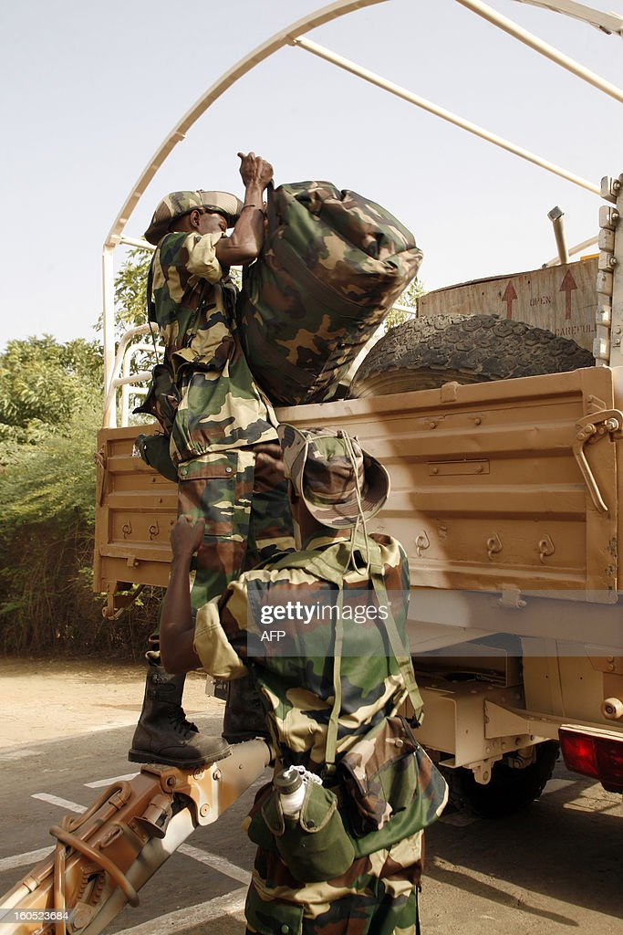A Senegalese soldier loads his equipment in a vehicle in the Captain Moussa Dioum military camp of Bargny, near Dakar, on February 2, 2013 in Dakar, before their departure for Mali as part of the second contingent of Senegalese troops to back Malian forces. President Francois Hollande arrived in Mali Saturday to push for African troops to replace French forces who led a lightning advance that drove back radical Islamists from the country's desert north. BEHAN