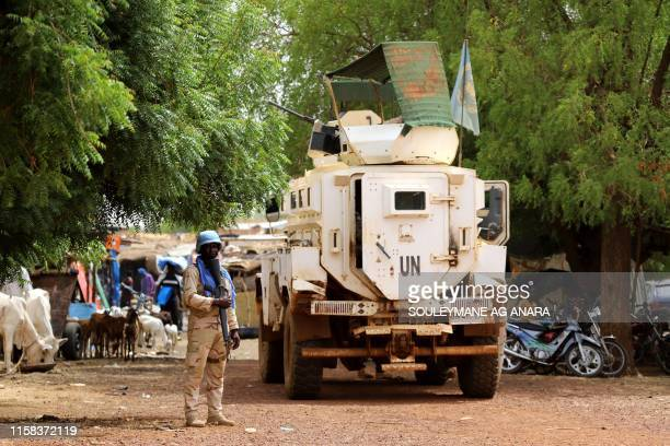 Senegalese soldier of the UN peacekeeping mission in Mali MINUSMA patrols in the streets of Gao, on July 24 a day after suicide bombers in a vehicle...