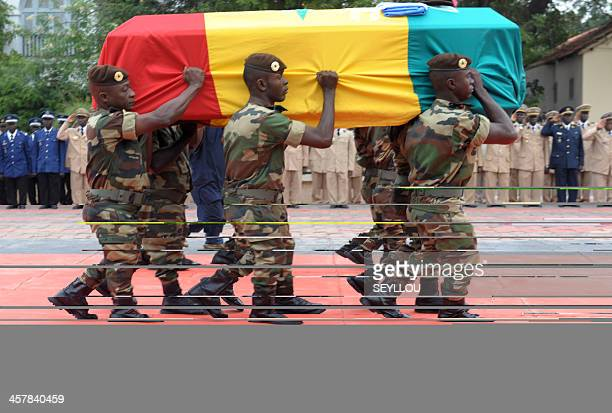 Senegalese soldiers carry on December 19 2013 in Dakar the coffin of one of the two Senegalese peacekeepers killed on December 14 in an attack in the...