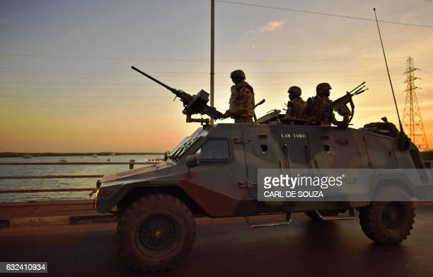 TOPSHOT Senegalese soldiers membrers of ECOWAS forces arrive in Banjul as they drive to secure the Statehouse on January 22 2017 ECOWAS troops...