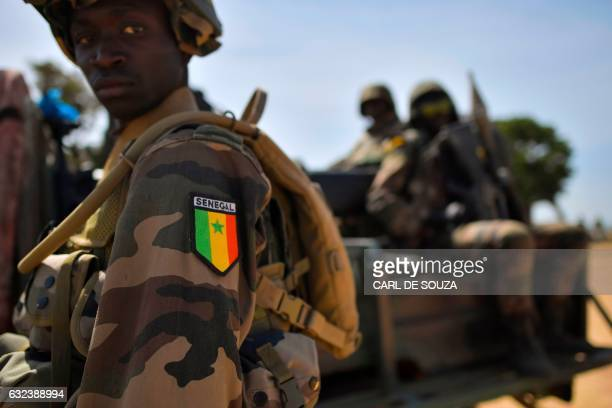TOPSHOT Senegalese soldiers membrers of ECOWAS forces patrol in Barra on January 22 2017 West African troops approached the Gambian capital on...