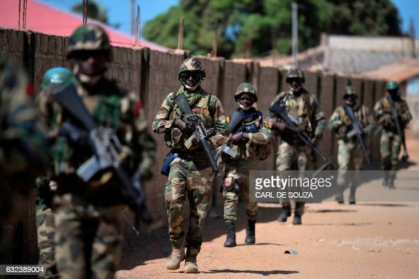 Senegalese soldiers membrers of ECOWAS forces patrol in Barra on January 22 2017 West African troops approached the Gambian capital on January 22...
