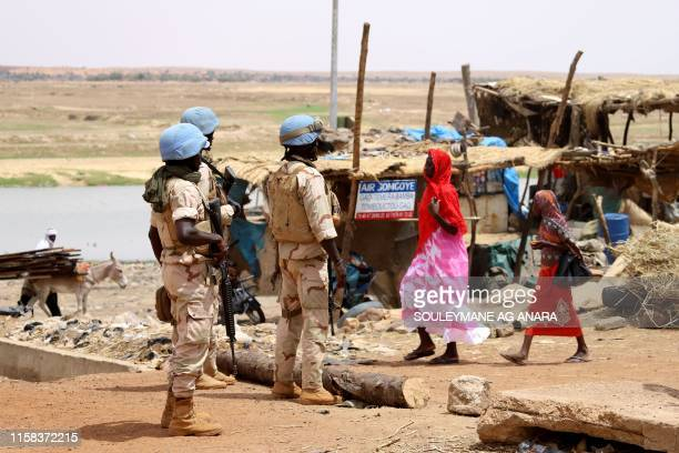 Senegalese soldiers of the UN peacekeeping mission in Mali MINUSMA patrol on foot in the streets of Gao, on July 24 a day after suicide bombers in a...
