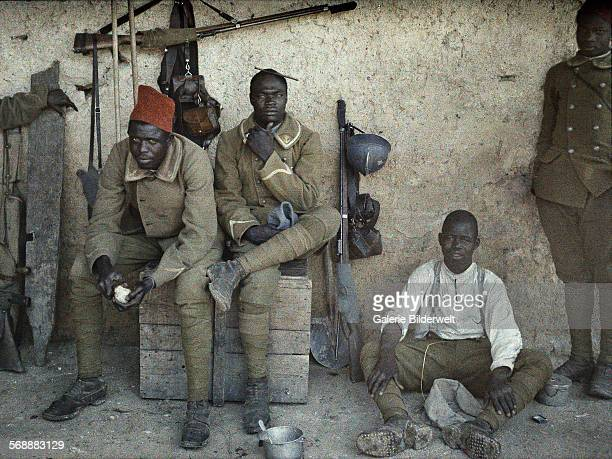 Senegalese soldiers serving in the French Army as infantrymen are resting in a room with guns and equipment next to them 16th June 1917 SaintUlrich...