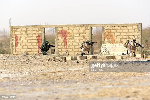 Senegalese soldiers stand guard with their guns as they take part on a large annual military exercise known as Flintlock on February 24 in Thies The...