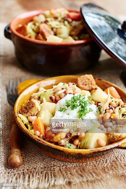 senegalese stew with black-eyed peas, cabbage, carrots, cassava and tempeh - black eyed peas food stock pictures, royalty-free photos & images