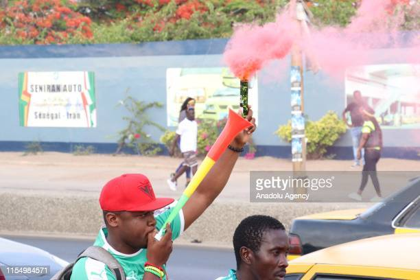 Senegalese supporters celebrate after their national team beat Benin 10 to advance to 2019 Africa Cup of Nations semifinals after quarter final match...
