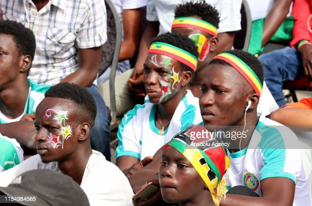 Senegalese supporters gather to watch 2019 Africa Cup of Nations quarter final match between Senegal and Benin on screens at Fann Residence Square in...