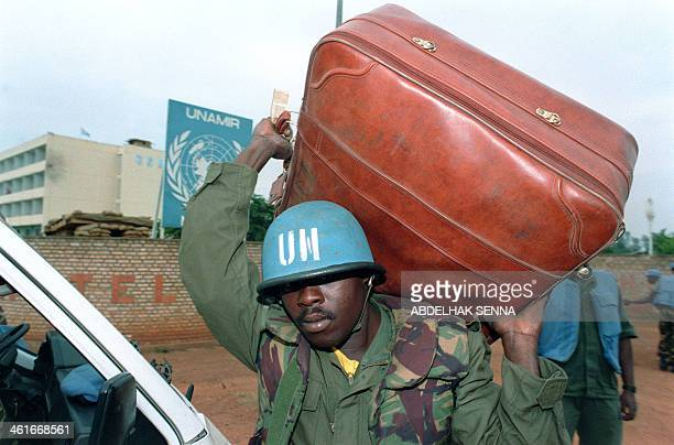 Senegalese United Nations military observer carries a suitcase 22 June 1994 in Kigali. UN military observers from Senegal, Congo and Togo will leave...