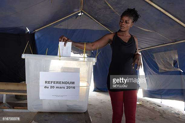 A Senegalese woman casts her ballot during a referendum on constitutional reforms in Dakar on March 20 2016 Senegal is holding a referendum on...
