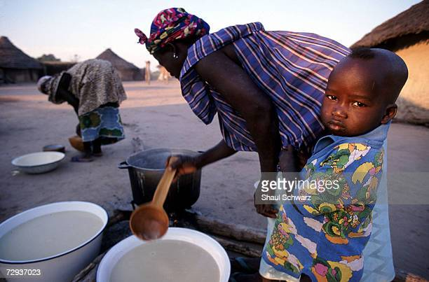 Senegalese women prepare to cook in the rural village of Dialakoto Senegal August 23 2001 In Senegal rural communities including Dialakoto home to...