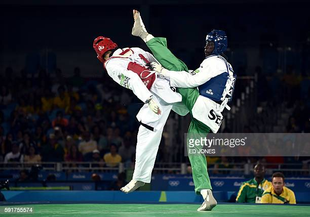 Senegal's Balla Dieye competes against Poland's Karol Robak during their men's taekwondo qualifying bout in the -68kg category as part of the Rio...