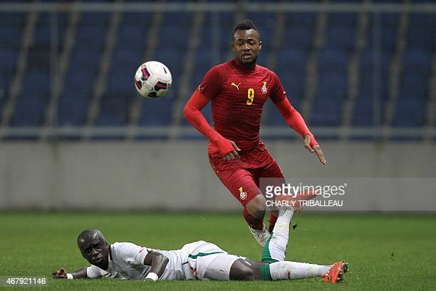 Senegal's Cheikh Mbengue vies for the ball with Ghana's Jordan Ayew during the International Friendly football match between Senegal and Ghana on...