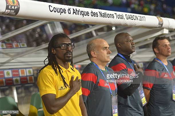 Senegal's coach Aliou Cisse and his coaching staff listen to the national anthems ahead of the 2017 Africa Cup of Nations group B football match...