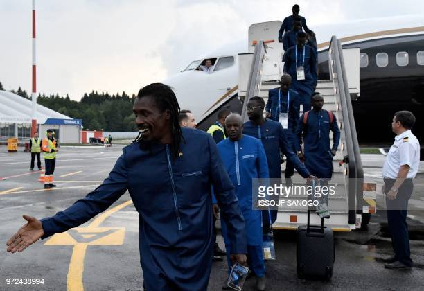 Senegal's coach Aliou Cisse and his players disembark from a plane upon the team's arrival in Kaluga on June 12 ahead of the Russia 2018 World Cup...