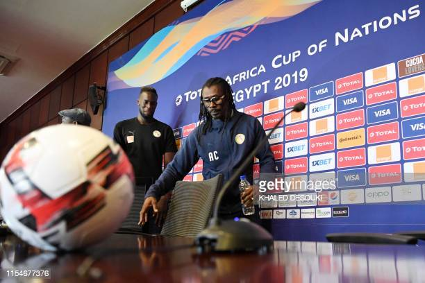 Senegal's coach Aliou Cisse and Senegal's defender Salif Sane attend a press conference on the eve of the 2019 Africa Cup of Nations quarter final...