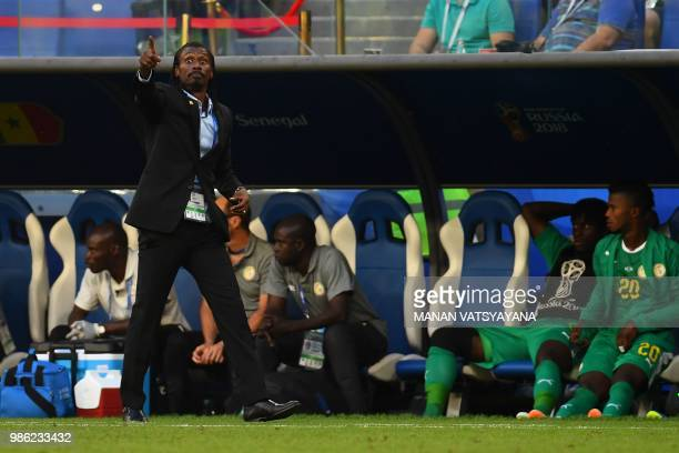 Senegal's coach Aliou Cisse gestures and reacts during the Russia 2018 World Cup Group H football match between Senegal and Colombia at the Samara...