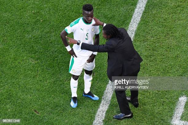 Senegal's coach Aliou Cisse gives instructions to Senegal's midfielder Idrissa Gana Gueye during the Russia 2018 World Cup Group H football match...