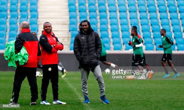 Senegal's coach Aliou Cisse looks on as his players warm up during a training session prior to a friendly football match between Senegal and Bosnia...