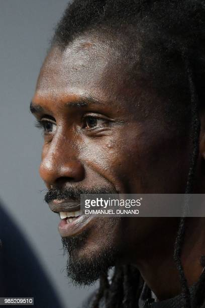 Senegal's coach Aliou Cisse smiles during a press conference on the eve of the Russia 2018 World Cup Group H football match between Colombia and...